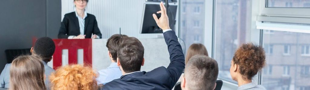 Man raising hand at meeting